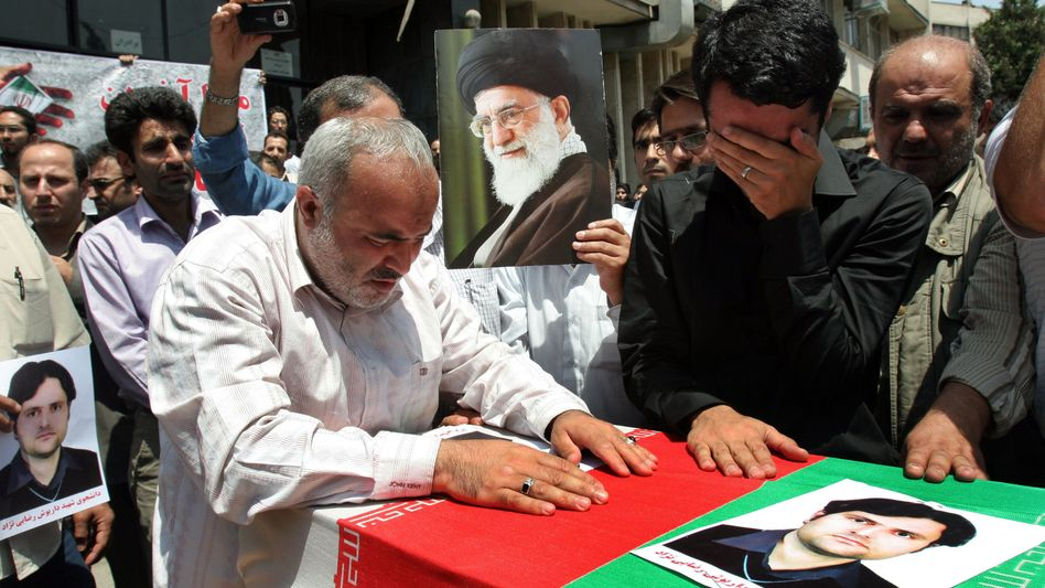 The funeral of Darioush Rezaei on July 24. Mossad has been blamed for the killing.