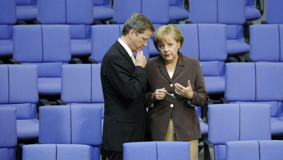 Guido Westerwelle und Angela Merkel: Die Länder werden sich das Geld zurückholen