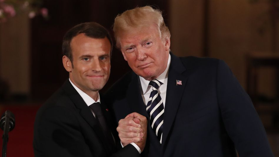 French President Emmanuel Macron with U.S. President Donald Trump.