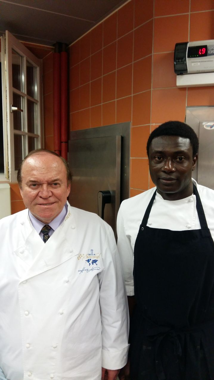 """Michelin star chef Heinz Winkler and Hagie Foday Jaiteh Kabba: """"A full-fledged member of our kitchen team."""""""