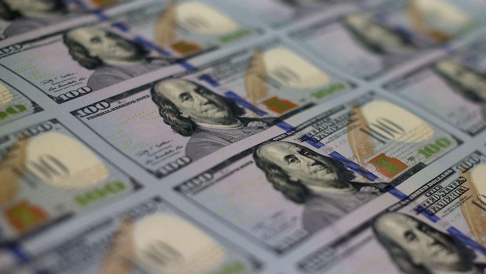 Reale Dollar wurden in digitale Währung umgetauscht - und so gewaschen: Die US-Justiz ließ fünf Männer festnehmen