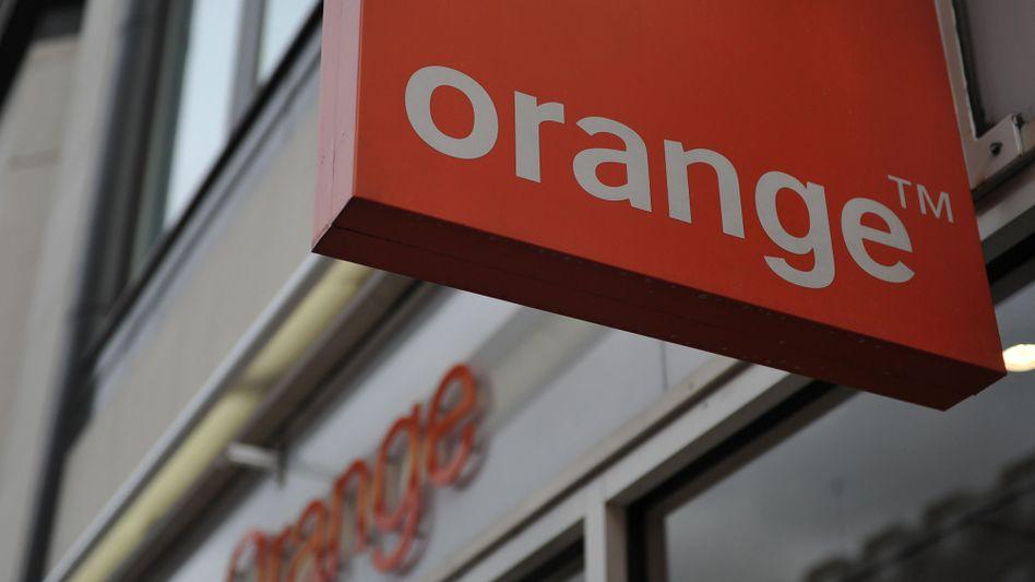 """Orange-Firmenlogo: """"Alles geschieht unter Verantwortung der Staatsgewalt"""""""