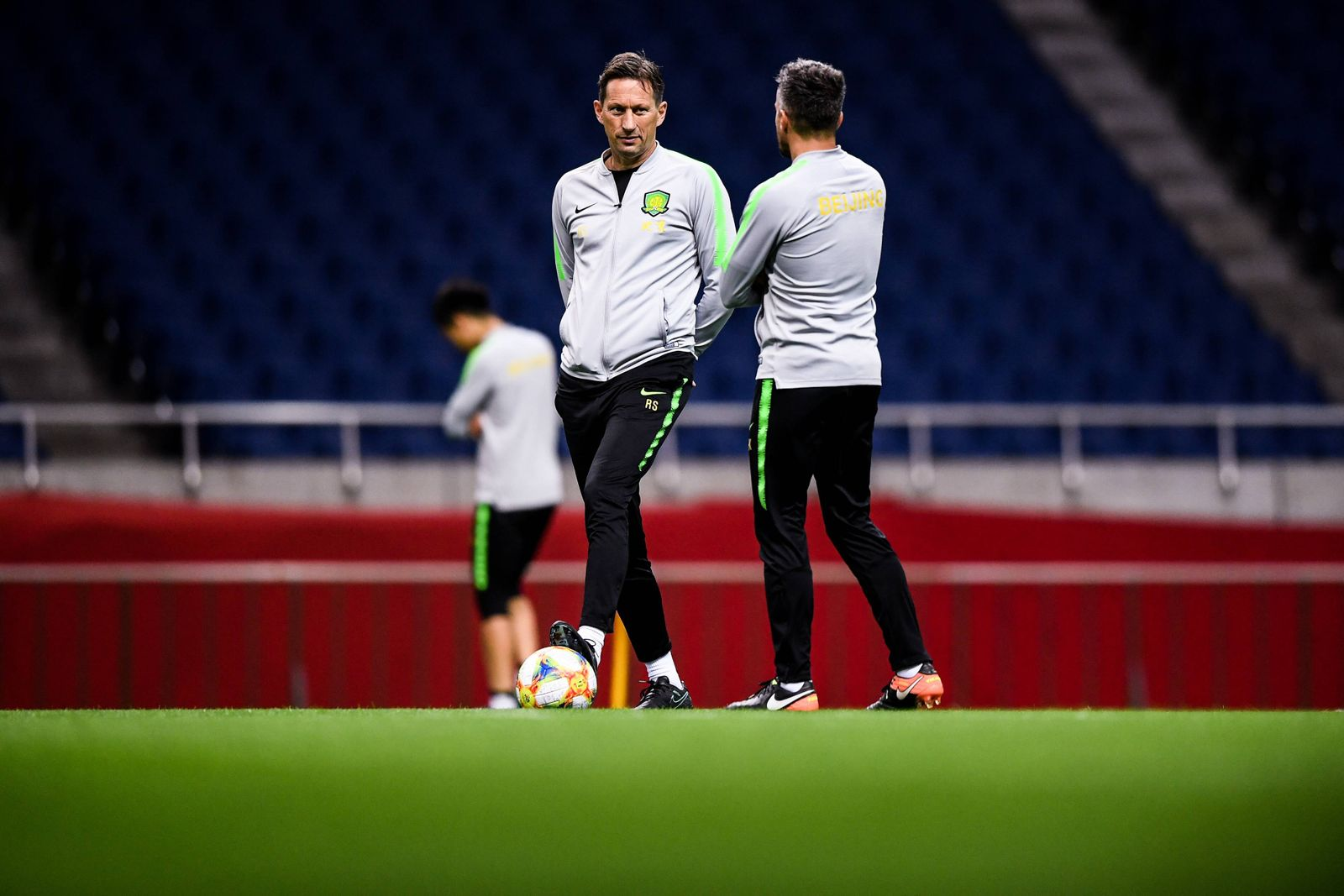 Head coach Roger Schmidt and his players of China s Beijing Guoan F C take part in a training sess