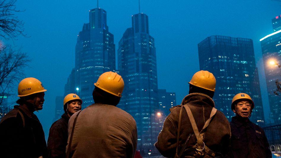 Wanderarbeiter in Peking: Globale Sorgen um Chinas Verfassung