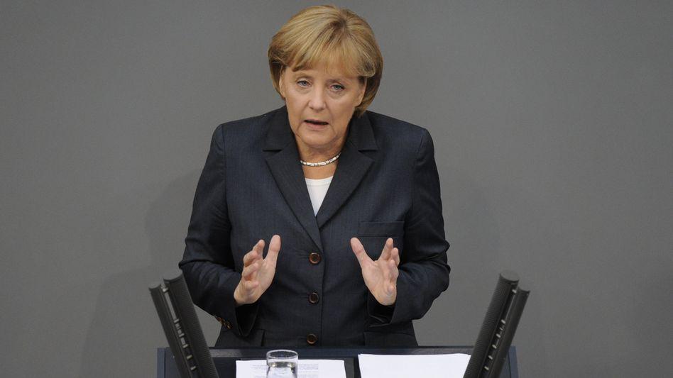 """We won't accept prejudments,"" German Chancellor Angela Merkel told the German parliament."