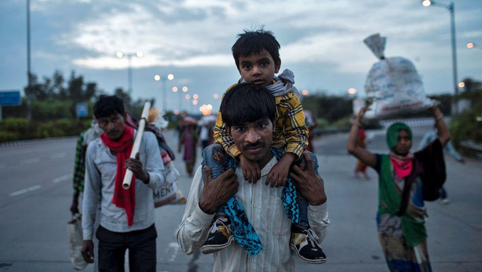 Exodus der Wanderarbeiter: Ohne Einkommen bleibt vielen von Indiens Ärmsten nur die Rückkehr in ihre Dörfer