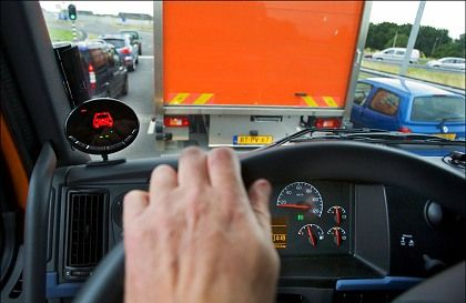 A Dutch truckdriver waits in traffic on one of Holland's many cluttered roads.