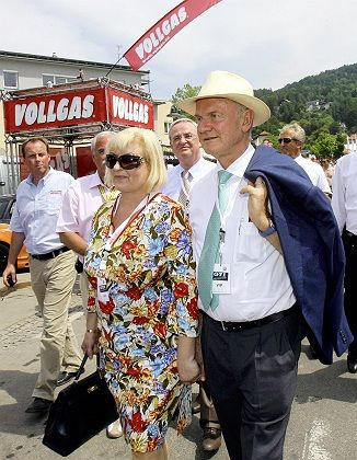 Porsche co-owner Ferdinand Piech (right) and his wife Ursula at a meeting of Volkswagen Golf GTI enthusiasts in Austria in May: VW has good reasons not to let Porsche slip into bankruptcy.
