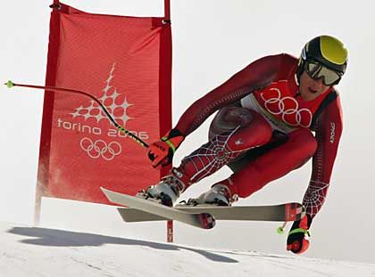 Austria's Hermann Maier passes a gate during the men's Olympic downhill race on February 12, 2006.