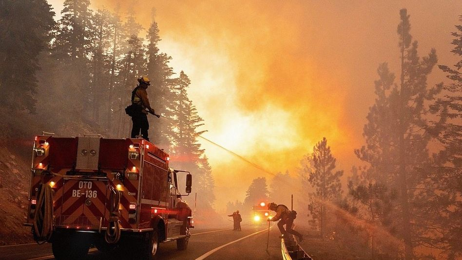 Firefighters battle a blaze in California's Angeles National Forest.
