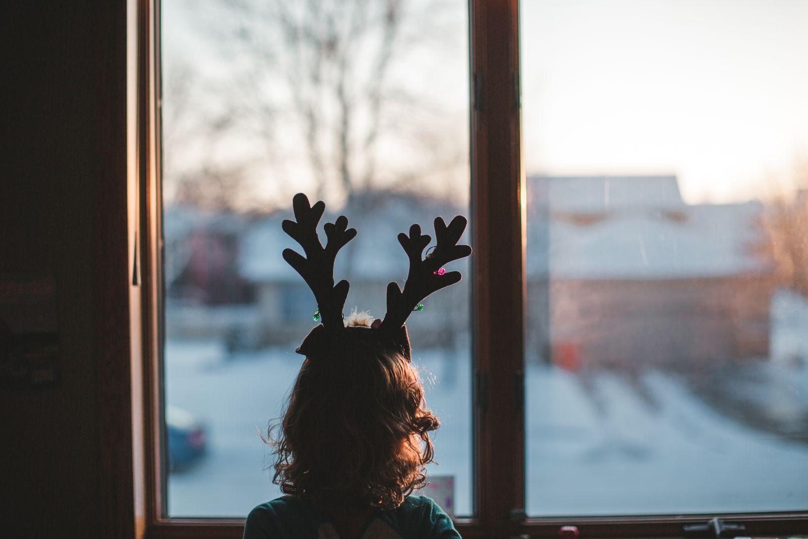 Girl with reindeer antlers window