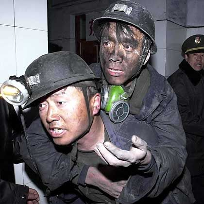 Rescuers at work following an accident in a Chinese mine: This kind of unbridled capitalism hasn't existed since the Wild West days of the industrial revolution.