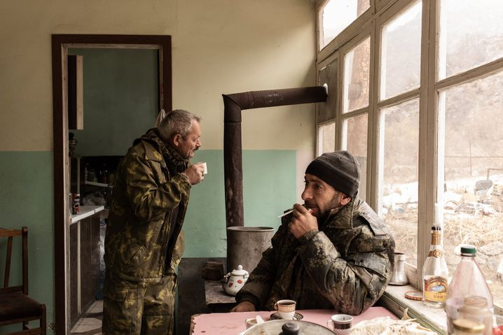 Volodya Grigoryan and his son-in-law in their home in Yeghegnut. They must now leave.