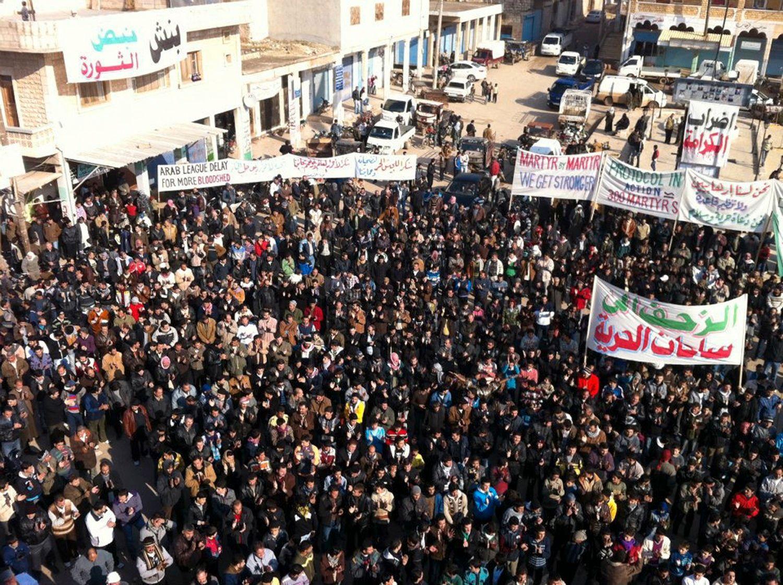 Demonstrators protest against Syria's President Bashar al-Assad in Binsh, near Adlb
