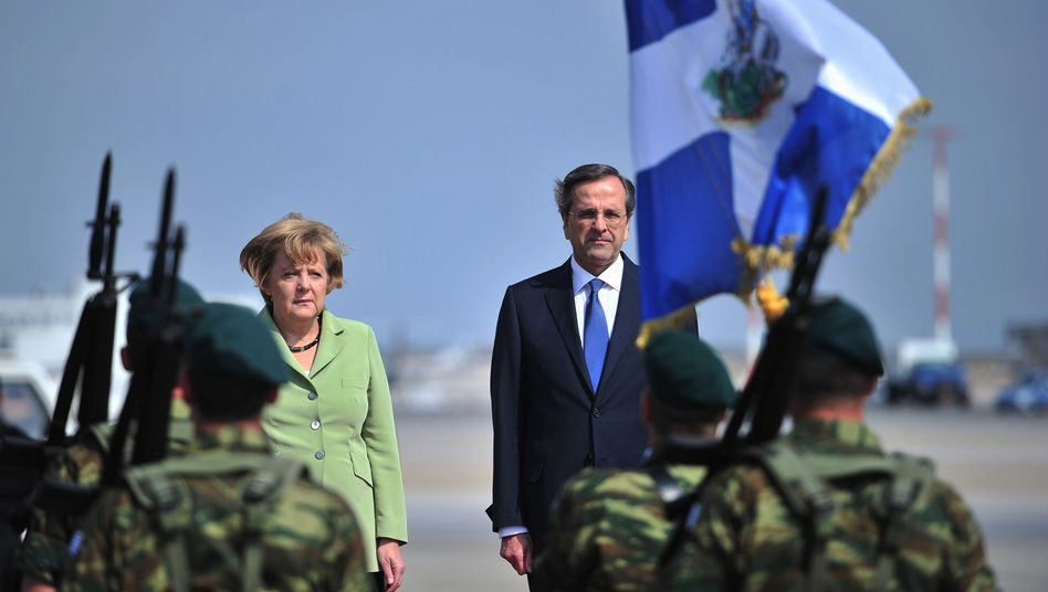 A visit among friends: Chancellor Angela Merkel and Greek Prime Minister Antonis Samaras on Tuesday.