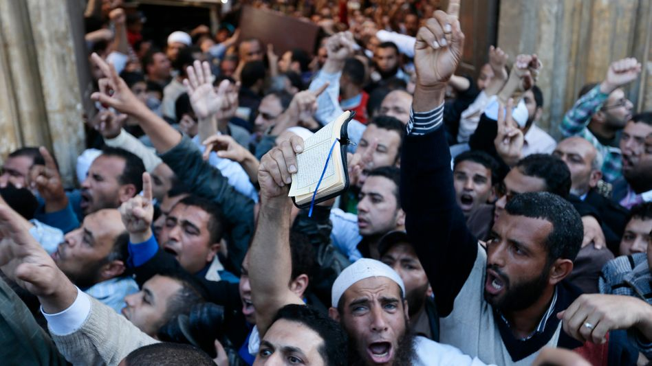 Muslim Brotherhood supporters carry the bodies of three dead into the Al-Azhar Mosque Friday.