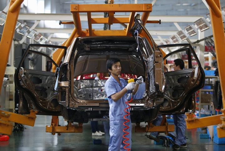 Workers at a Chinese automobile factory
