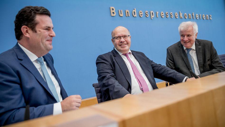 Bundesminister Heil (SPD), Altmaier (CDU), Seehofer (CSU)