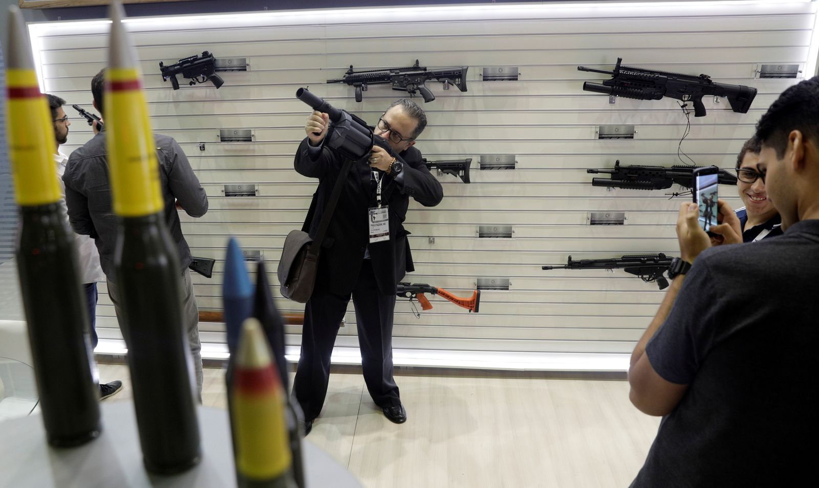 A man holds a gun during LAAD, the biggest military industry expo in Latin America in Rio de Janeiro