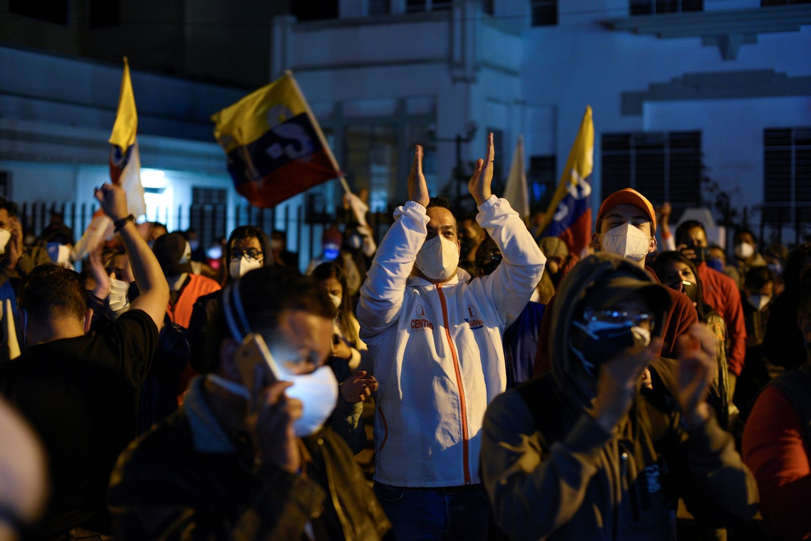 Supporters of Ecuador's presidential candidate Andres Arauz (not pictured) gather while waiting for official results of the presidential election, in Quito
