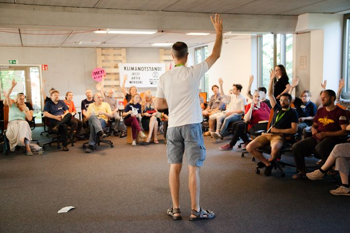 New activists receive protest training at a coworking space in Hamburg.