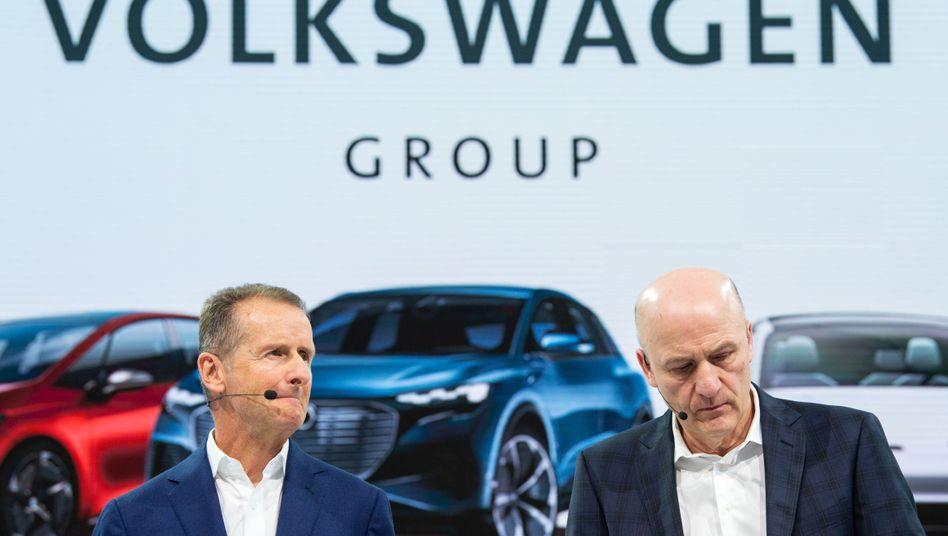 Volkswagen-Chef Herbert Diess und Finanzvorstand Frank Witter: Gedämpfte Erwartungen