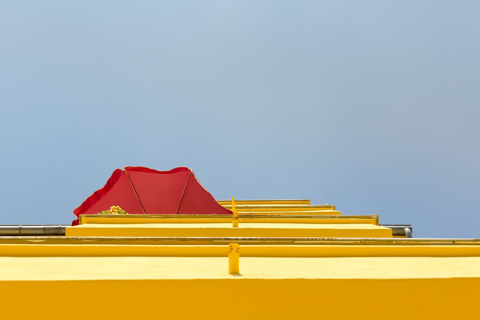 Low Angle View Of Yellow Wall Against Clear Sky