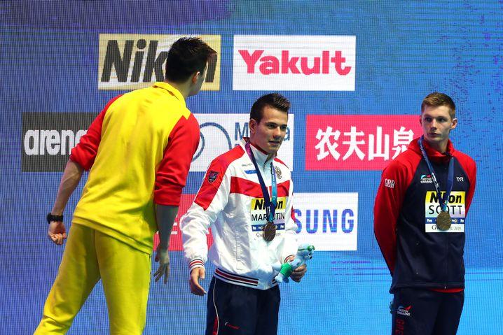 Sun Yang ruft in Richtung von Duncan Scott