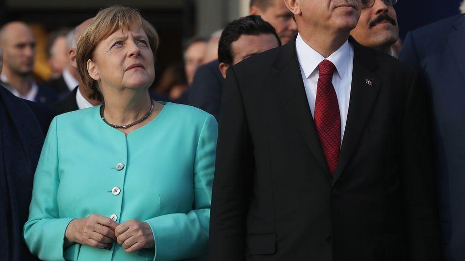 Merkel und Erdogan in Warschau