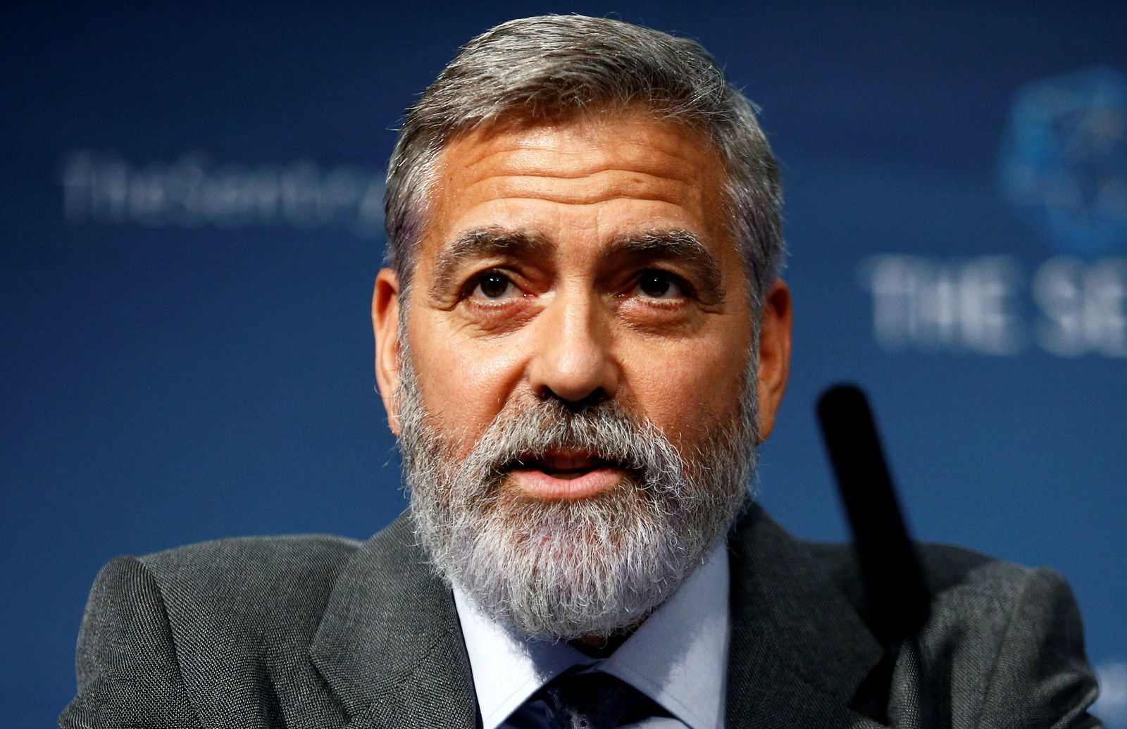 FILE PHOTO: George Clooney speaks at an event about corruption in Africa, in London