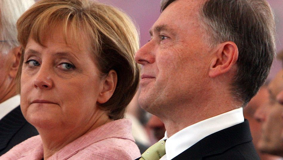 German Chancellor Angela Merkel und President Horst Köhler, who resigned on Monday.