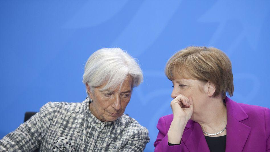 Angela Merkel und Christine Lagarde: Was tun mit Griechenlands Schulden?