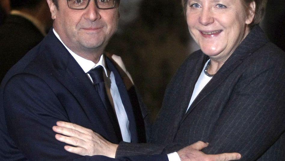 Frankreichs Präsident Hollande und Angela Merkel (Archiv): Gemeinsame Forderung im Ukraine-Konflikt