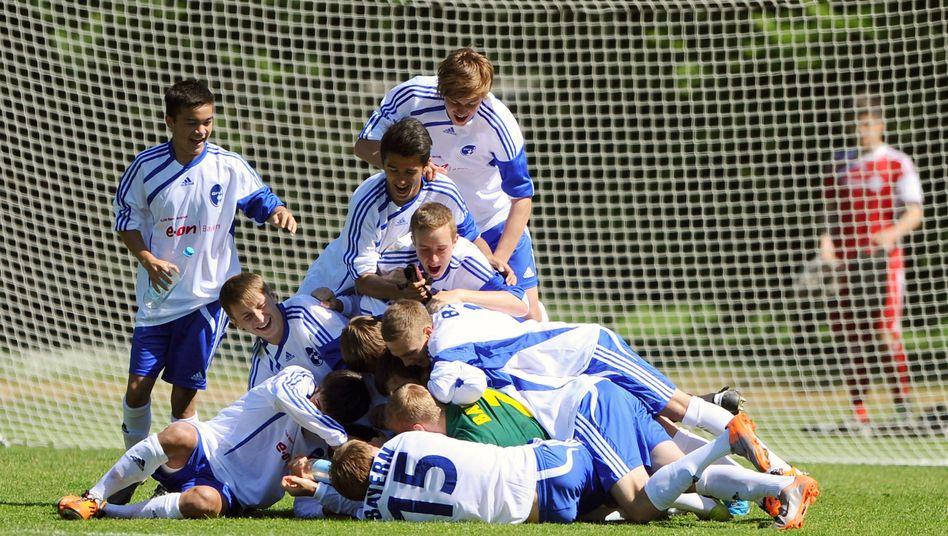 Jubelnde Jugendfußballer