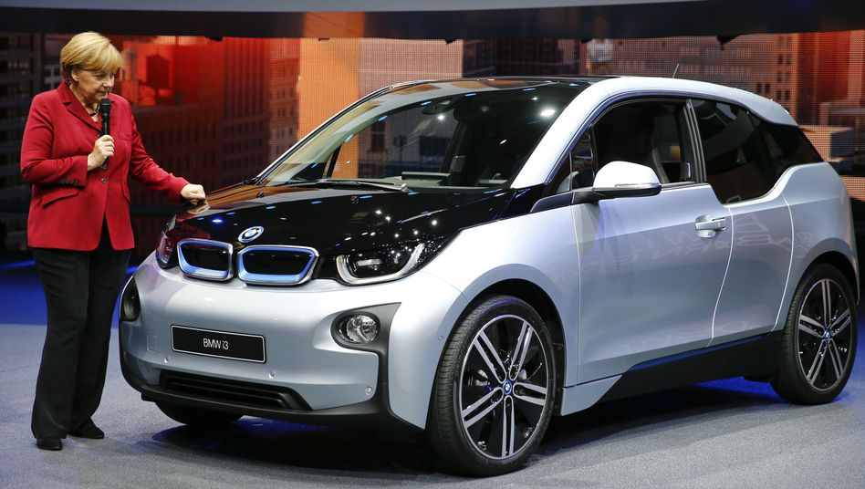 Angela Merkel inspects the new BMW i3 electric car at the Frankfurt Motor Show in September.