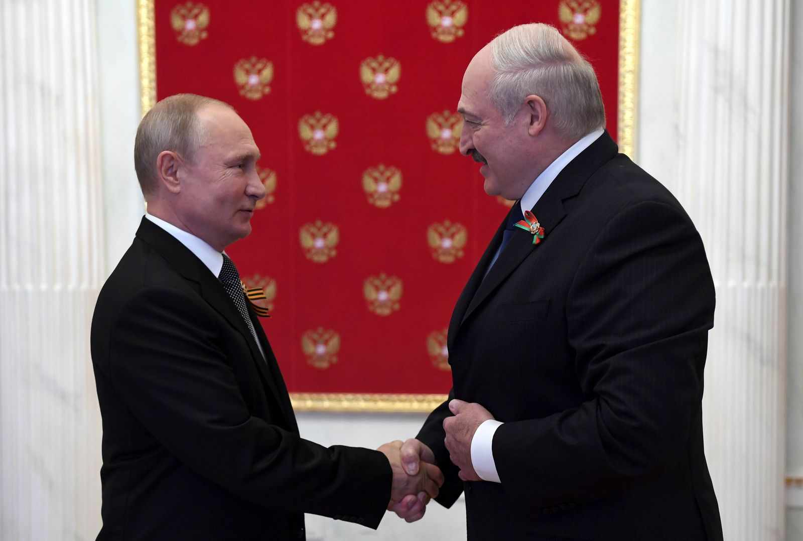 MOSCOW, RUSSIA - JUNE 24, 2020: Russia s President Vladimir Putin (L) and Belarusian President Alexander Lukashenko shak