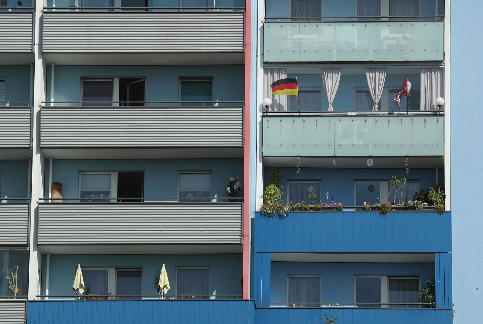 German flag hangs from a balcony