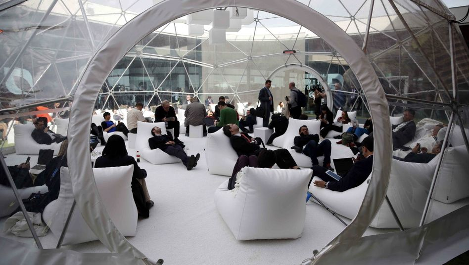 Visitors at a mobile telecommunications conference in Barcelona. Jean-Claude Juncker wants Europe to get its technological act together.