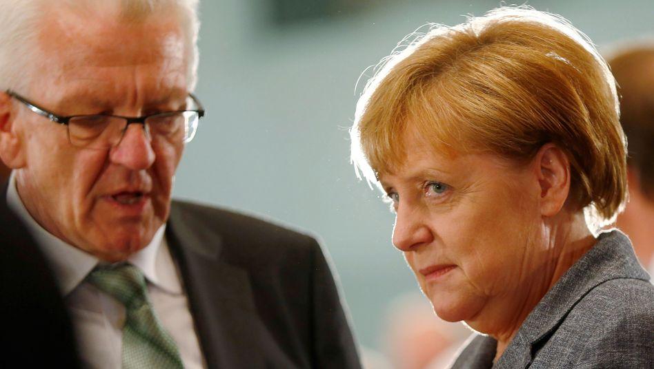 Kanzlerin Merkel, Grünen-Politiker Kretschmann