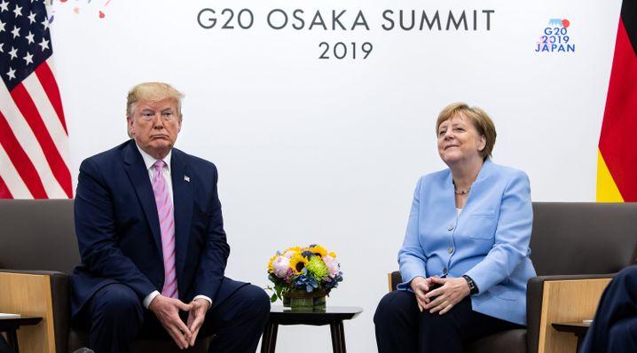Trump und Merkel in Osaka