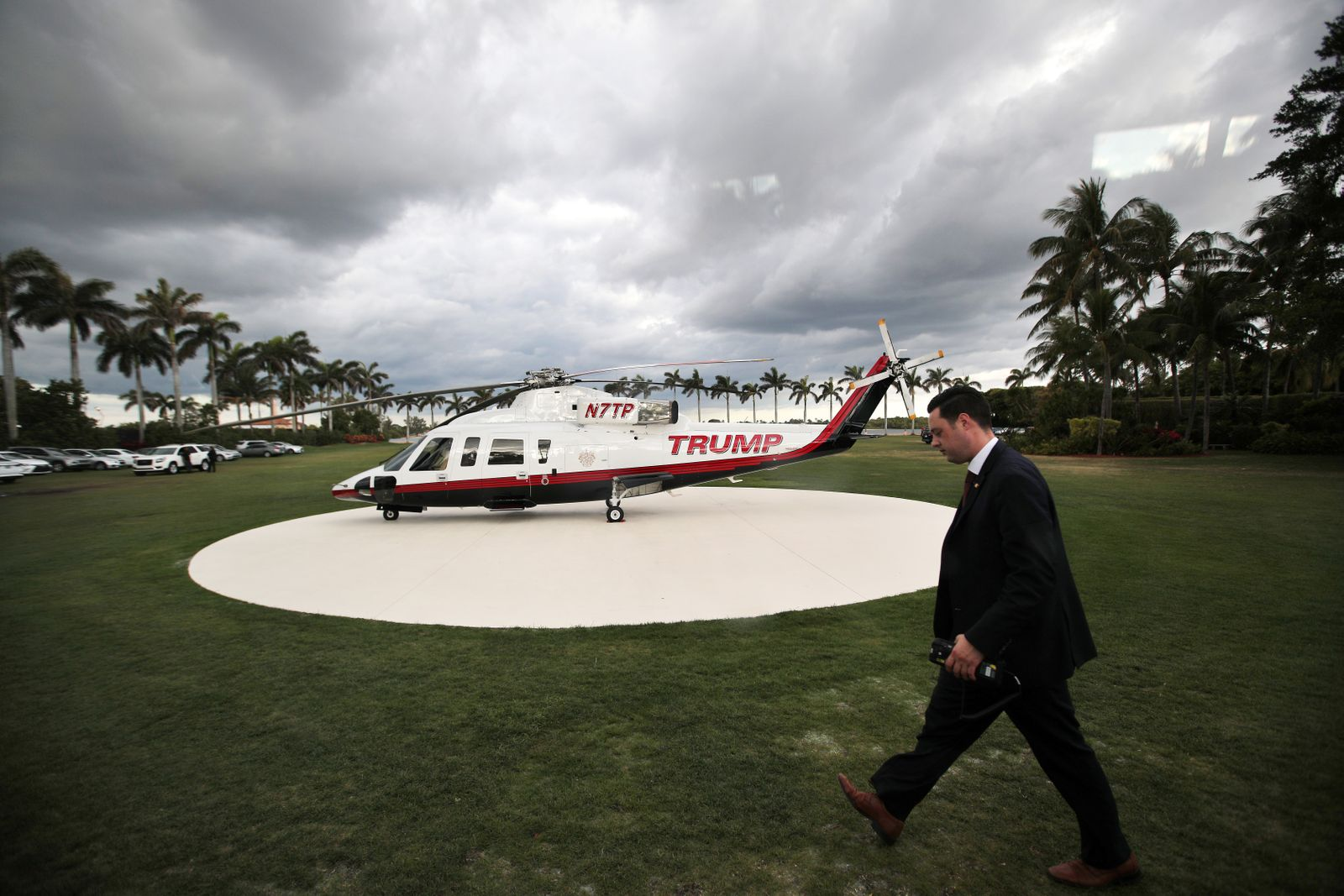 A members of the secret service walks by U.S. President Donald Trump's personal helicopter at Mar-a-Lago estate in Palm Beach, Florida, U.S.