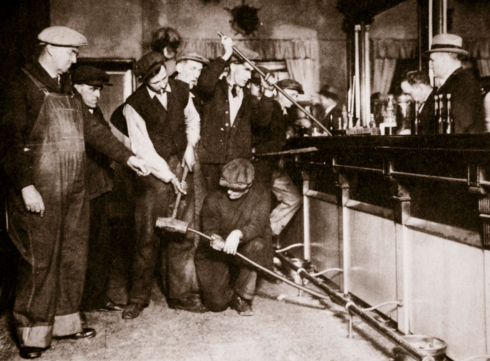 Prohibition - A bar in Camden, New Jersey, being forcibly dismantled by dry agents, USA, 1920s.