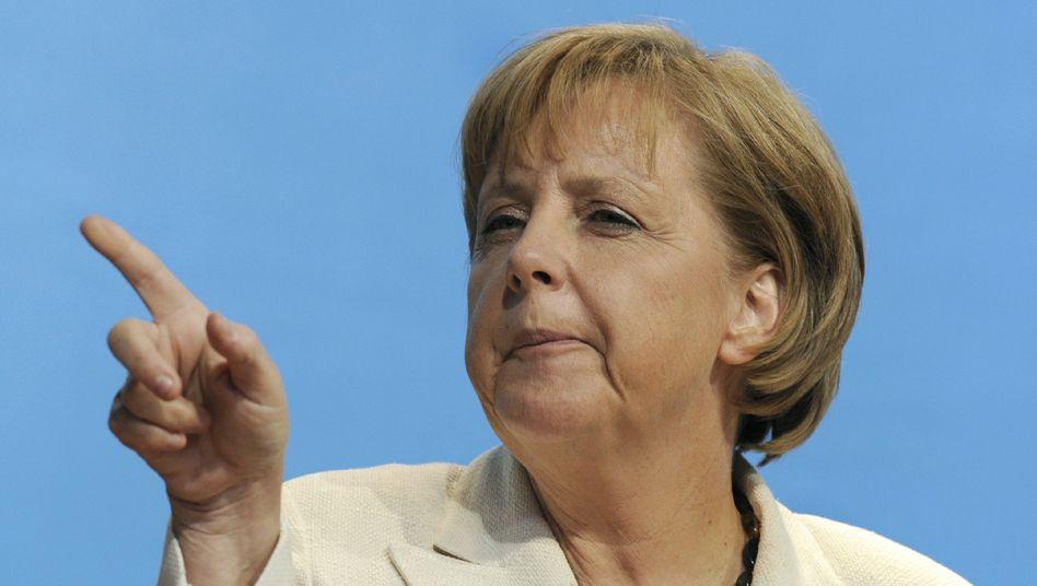 Angela Merkel: Sie behauptet, es sei besser für das Land, wenn die Härte der Krise bei den Leuten ankommt