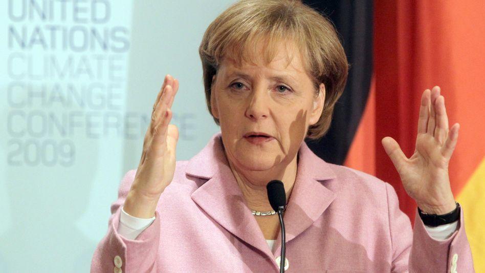 Angela Merkel (bei der Klimakonferenz in Kopenhagen): Sparsam in Sachen Klimaschutz