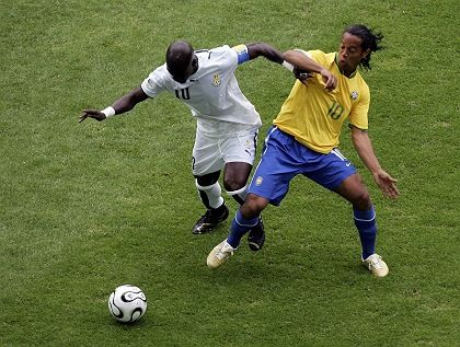 Stephen Appiah of Ghana and Ronaldinho of Brazil battle for the ball during the World Cup game in 2006. Now there are allegations that the Ghana players threw the game.