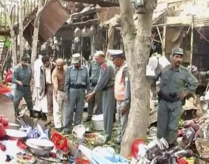 A video grab shows Afghan soldiers at the site of a suicide bomb blast at a market in Kunduz.