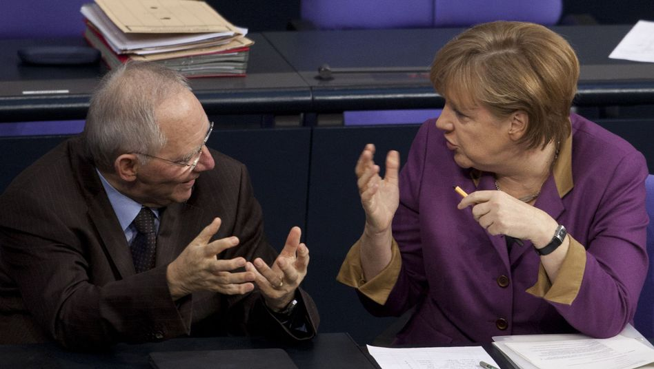 Chancellor Merkel, right, talks with Finance Minister Schäuble in the Bundestag.
