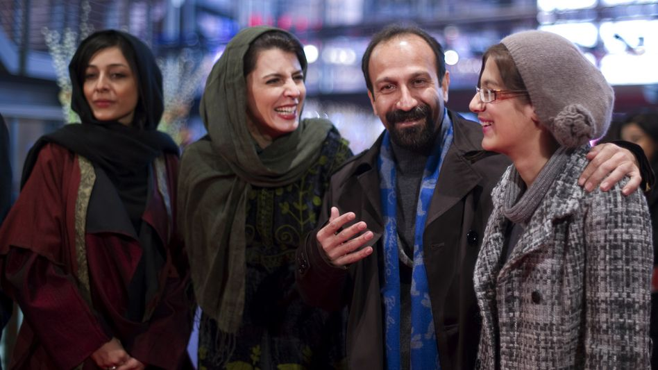 "Iranian director Asghar Farhadi and members of his cast arrive at the premiere of ""Nader And Simin, A Separation"" on Feb. 15 at the Berlinale. From left to right: Sareh Bayat, Leila Hatami, Farhadi and Sarina Farhadi."
