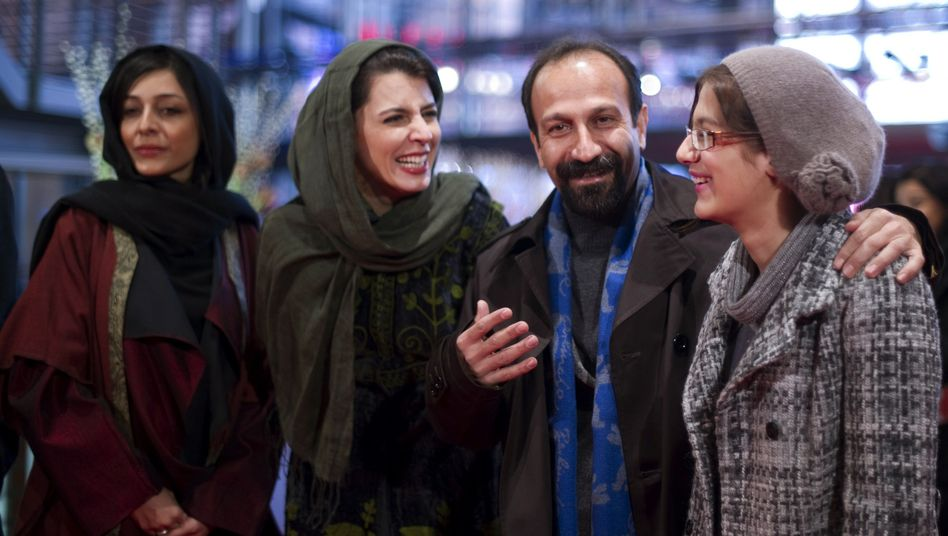 "Iranian director Asghar Farhadi and members of his cast arrive at the premiere of ""Nader And Simin, A Separation"" on Feb. 15 at the Berlinale. From left to right: Sareh Bayat, Leila Hatami, Farhadi and Sarina Farhadi."