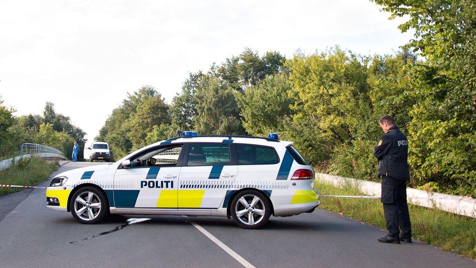 Dänische Polizei am Tatort